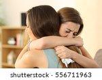 girl embracing to comfort to... | Shutterstock . vector #556711963