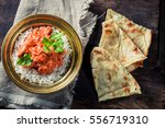 tikka masala with rice and... | Shutterstock . vector #556719310