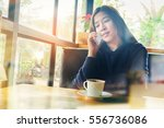 woman using on mobile phone... | Shutterstock . vector #556736086