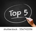 a hand writing 'top 5' on... | Shutterstock . vector #556742356