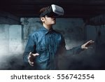 man using virtual reality... | Shutterstock . vector #556742554