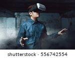 man using virtual reality... | Shutterstock . vector #556742554
