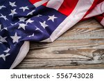 american flag on wood background | Shutterstock . vector #556743028