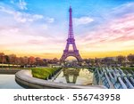 eiffel tower at sunset in paris ... | Shutterstock . vector #556743958