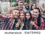 young happy friends  gesturing... | Shutterstock . vector #556759903