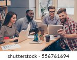 young active diverse team... | Shutterstock . vector #556761694