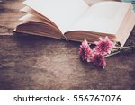 Small photo of Vintage novel books with bouquet of flowers on old wood background - concept of nostalgic and remembrance in spring vintage background
