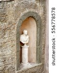 Small photo of Bust in an arched alcove on a building in Rome