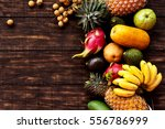 Tropical Fruit On Dark Wooden...