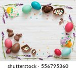 Small photo of Easter Eggs Over Blue Wooden Background