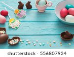 easter eggs over blue wooden... | Shutterstock . vector #556807924