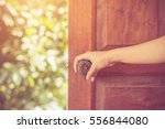women hand open door knob or... | Shutterstock . vector #556844080
