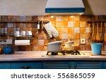 interior blue kitchen.... | Shutterstock . vector #556865059