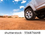 truck in desert with mountains... | Shutterstock . vector #556876648