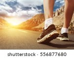 legs in sport shoes on road at... | Shutterstock . vector #556877680
