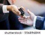 car salesman handing over the... | Shutterstock . vector #556896844