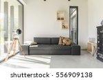 white living room with black... | Shutterstock . vector #556909138