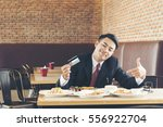 rich man in business suit using ... | Shutterstock . vector #556922704