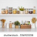 modern kitchen shelves with... | Shutterstock . vector #556935358