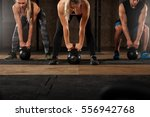 group of muscular adults doing... | Shutterstock . vector #556942768