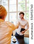 businessman shanke hands with... | Shutterstock . vector #556953760