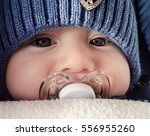 baby face close up with a... | Shutterstock . vector #556955260