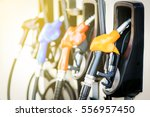 Colorful Petrol pump filling  nozzles isolated on white background , Gas station in a service in warm sunset