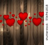 red hearts on brown wooden... | Shutterstock .eps vector #556961818