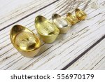 gold ingots and red money... | Shutterstock . vector #556970179