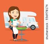 caucasian woman cooking steak... | Shutterstock .eps vector #556978174