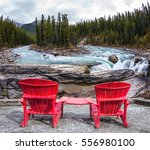 two red deckchairs stand on the ... | Shutterstock . vector #556980100