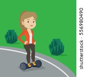 young caucasian woman riding on ... | Shutterstock .eps vector #556980490