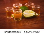 tequila   lime and salt on... | Shutterstock . vector #556984930