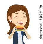caucasian joyful woman eating... | Shutterstock .eps vector #556994170