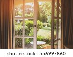 open door and nature. green... | Shutterstock . vector #556997860