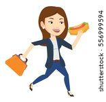 business woman in a hurry... | Shutterstock .eps vector #556999594