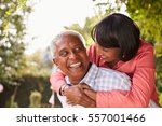 senior black couple piggyback ... | Shutterstock . vector #557001466