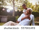 young black boy embracing... | Shutterstock . vector #557001493