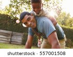 young black boy playing on dad  ... | Shutterstock . vector #557001508
