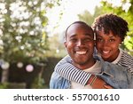 happy young black couple... | Shutterstock . vector #557001610