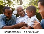 black grandfather  sons and... | Shutterstock . vector #557001634