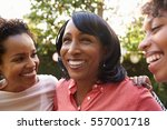 black mother and two adult... | Shutterstock . vector #557001718