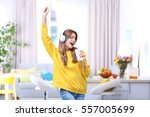 Beautiful Young Woman Listening ...