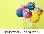 colorful cake pops on a yellow... | Shutterstock . vector #557005978