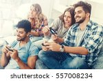 excited friends playing video... | Shutterstock . vector #557008234