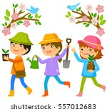 three kids going to plant trees | Shutterstock . vector #557012683