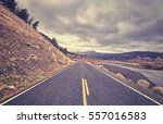 vintage toned scenic road with... | Shutterstock . vector #557016583