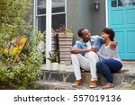 young couple sit looking at... | Shutterstock . vector #557019136