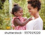young african american mother... | Shutterstock . vector #557019220