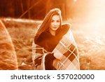 in the sunset smiling girl... | Shutterstock . vector #557020000